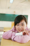 Asian girl in classroom Stock Photos