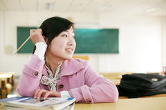 Asian girl in classroom Royalty Free Stock Photos