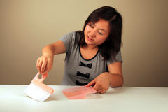 Asian girl cleaning Royalty Free Stock Images