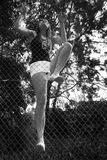 Asian girl climbing fence Royalty Free Stock Photos