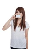 Asian girl close her mouth with a blank card Stock Photos