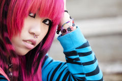 Asian girl close portrait. Young asian pink haired girl portrait Stock Photo