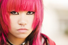 Asian girl close portrait. Young asian pink haired girl portrait Royalty Free Stock Photo