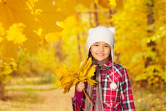 Asian girl close up view with bunch of leaves Royalty Free Stock Images