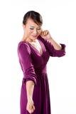 Asian Girl closing ear. Beautiful Asian woman in purple dress closing one ear Royalty Free Stock Images