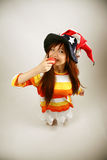 Asian girl clown getting ready to eat Royalty Free Stock Photos