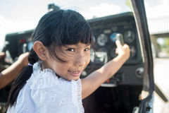 Asian girl in cockpit of plane with sunny day. Stock Photography