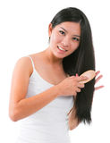 Asian girl combing hair Royalty Free Stock Images