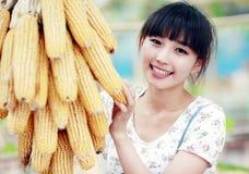 Asian girl in the countryside. Happy Asian summer girl enjoying the fun of farm life Stock Photography