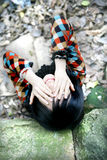 Asian girl covering eyes. Asian girl covering her eyes with both hands Stock Photo
