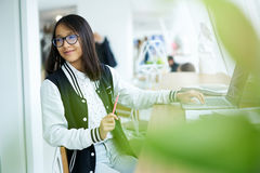 Asian girl in coworking waiting for consultancy with teacher Stock Photos