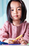 Asian girl with crayons Stock Photo