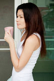 Asian girl with a cup of coffee Stock Image