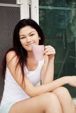 Asian girl with a cup of coffee Royalty Free Stock Image