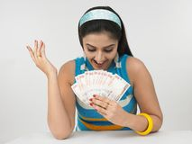 Asian girl with currency notes. Asian female of indian origin with currency notes Royalty Free Stock Image