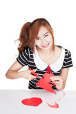 Asian girl cut heart shape paper and smile Stock Photos