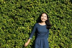 Asian girl cute smile face on green park stock photo