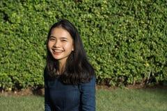 Asian girl cute smile face on green park stock photos