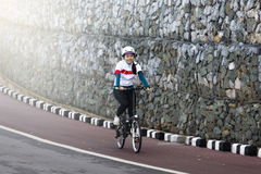 The asian girl cycling Royalty Free Stock Images