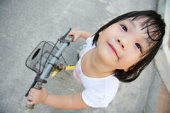 Asian girl cycling Royalty Free Stock Images