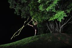 Asian girl dancing ballet under big tree at night royalty free stock photos