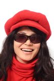 Asian girl in dark glasses. Laughing Asian girl in dark glasses, red cap and scarf, isolated on white background Stock Photos