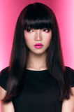 Asian girl with dark haircut Royalty Free Stock Photo