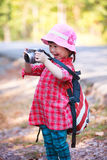 Asian girl with digital camera in beautiful outdoor. Royalty Free Stock Photos