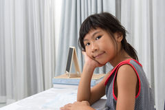 Asian girl doing homework at home Stock Photos