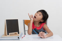 Asian girl doing homework at home Royalty Free Stock Photography
