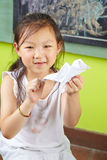 Asian girl doing origami bird Royalty Free Stock Image