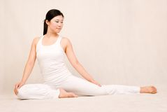 A asian girl doing yoga Stock Photography