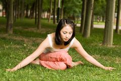 A asian girl doing yoga. A asian Chinese girl doing yoga exericise outdoors Stock Photo