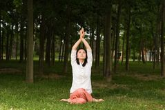 A asian girl doing yoga. A asian Chinese girl doing yoga exericise outdoors Royalty Free Stock Photos