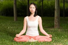 A asian girl doing yoga. A asian Chinese girl doing yoga exericise outdoors Royalty Free Stock Images