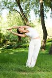 A asian girl doing yoga. A asian Chinese girl doing yoga exericise outdoors Stock Photos