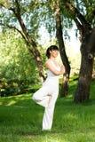 A asian girl doing yoga Stock Photos