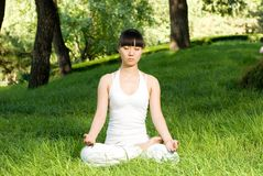 A asian girl doing yoga. A asian Chinese girl doing yoga exericise outdoors Royalty Free Stock Image