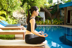 Asian Girl doing yoga Royalty Free Stock Photography