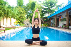 Asian Girl doing yoga pose Royalty Free Stock Images