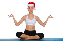 Asian girl doing yoga in a red cap Royalty Free Stock Image