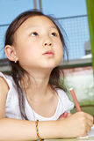 Asian girl drawing in kindergarten Royalty Free Stock Photography