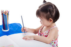 Asian girl drawing picture Stock Photo