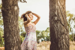 Asian girl in dress near a tree. Girl Asian girl in dress near a tree Stock Images