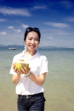 Asian girl drinking coconut on the beach Royalty Free Stock Image