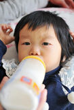 Asian girl is drinking milk Royalty Free Stock Photo