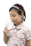 Asian girl drinking pure water on white and clipping path Stock Image