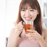 Asian girl drinking tea Stock Photos