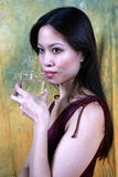 Asian girl drinking water. An Asian girl drinking water royalty free stock photos