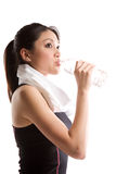 Asian girl drinking water and exercise Stock Photography